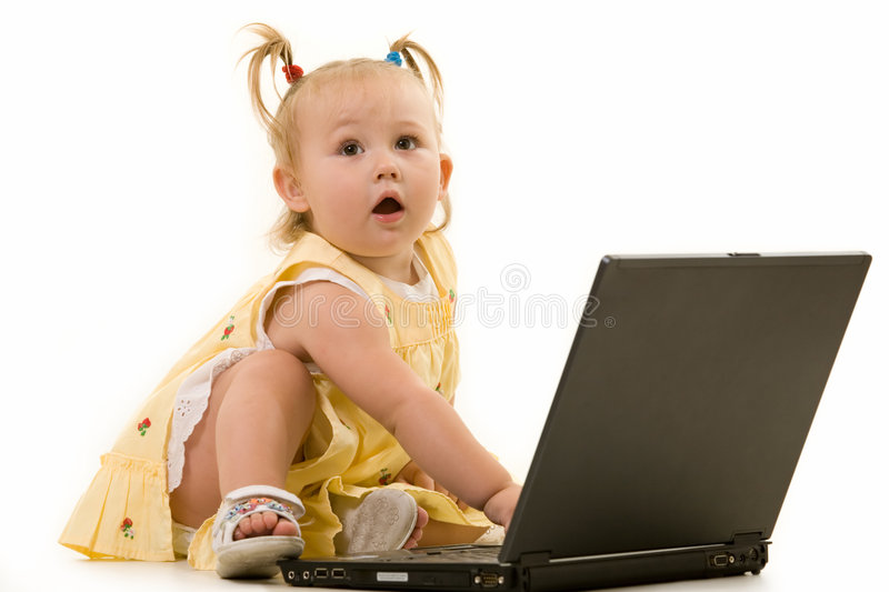 Baby on laptop stock images