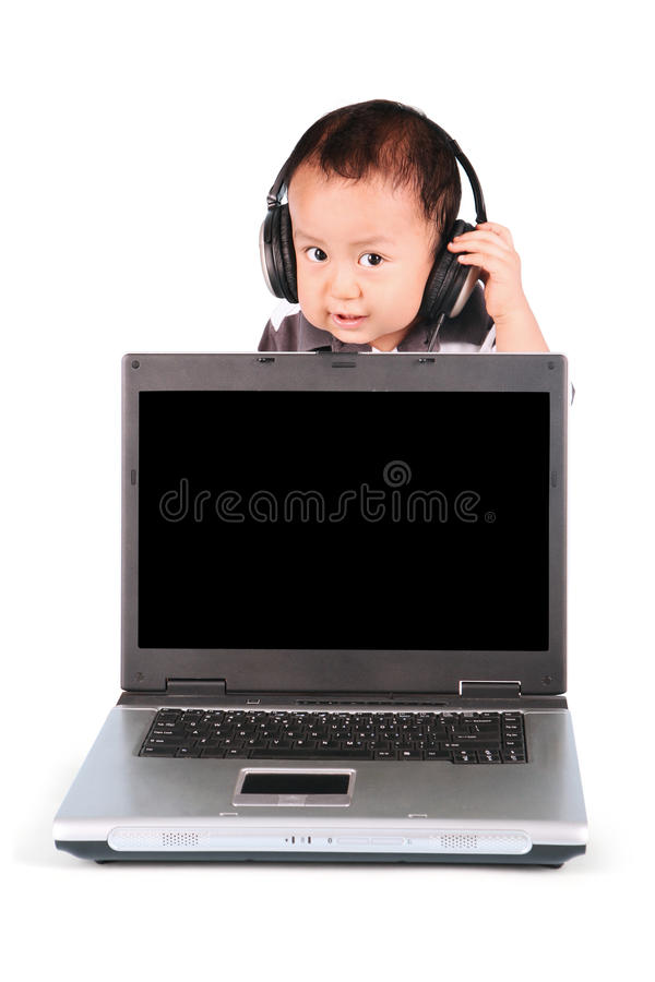 Baby with laptop and wearing headphones. Cute baby wearing headphones and showing a laptop with blank screen, isolated on white background stock photography