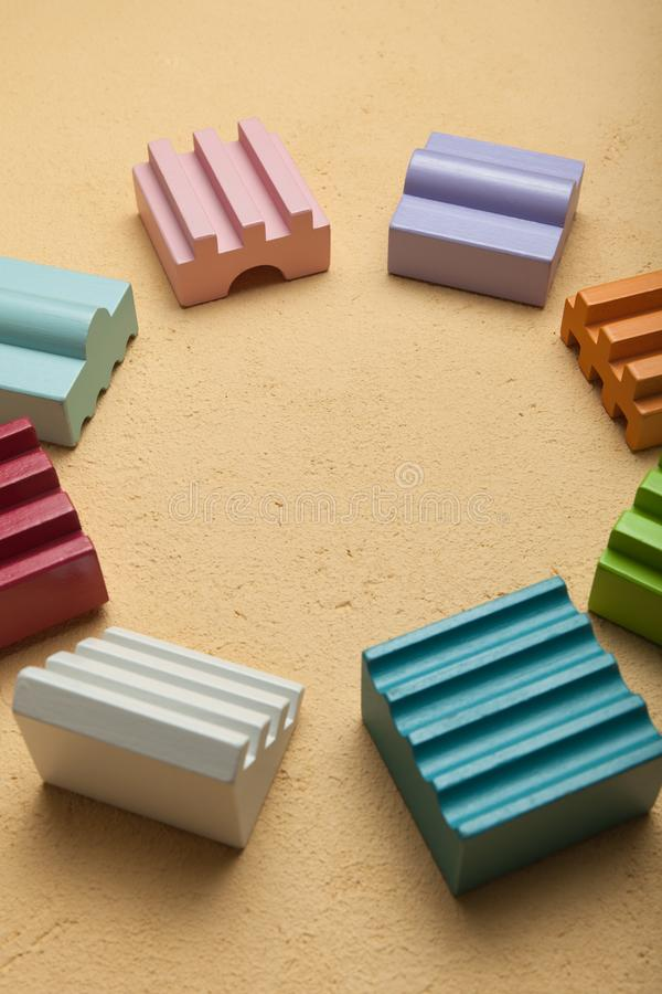 Baby large blocks on a brown background lined in a circle royalty free stock photos
