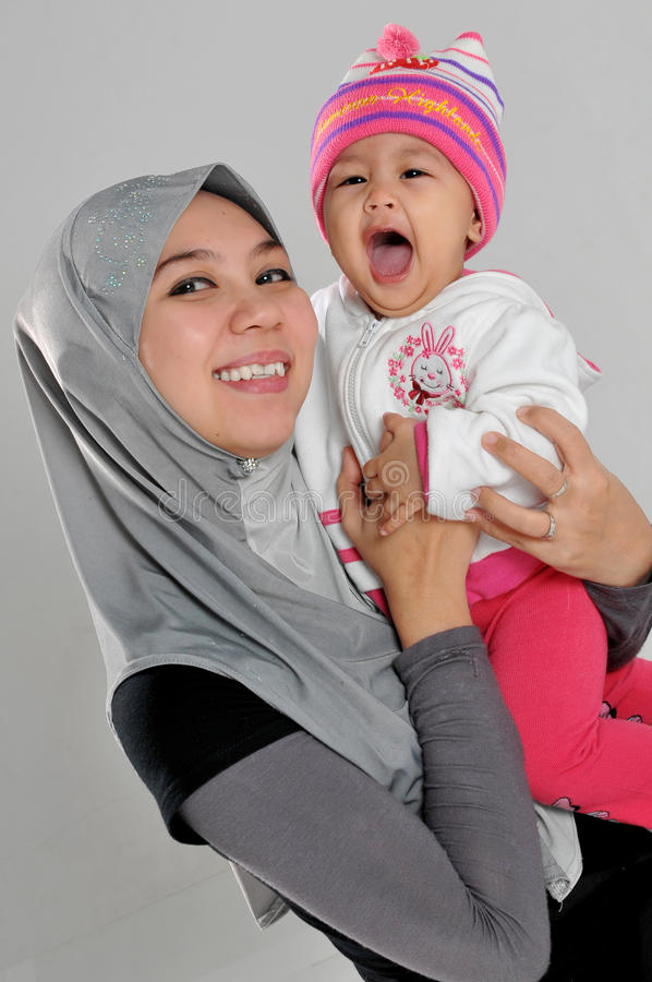 Baby laugh with mother stock photo