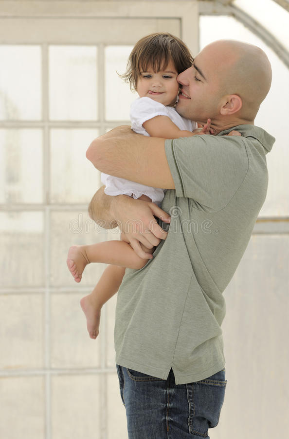 Baby Laughing in Father's Arms stock photo