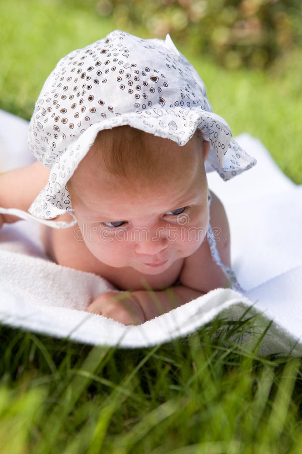 Download Baby laying in the grass stock image. Image of sunlight - 16505021