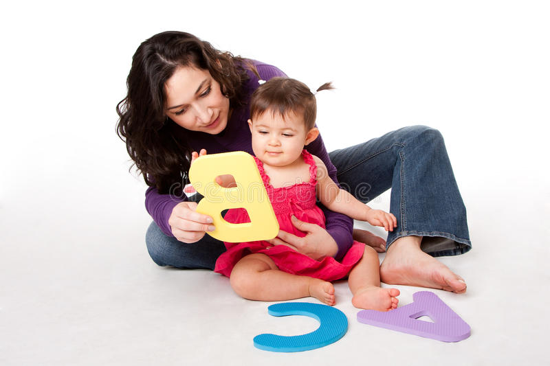 Baby learning alphabet ABC stock image