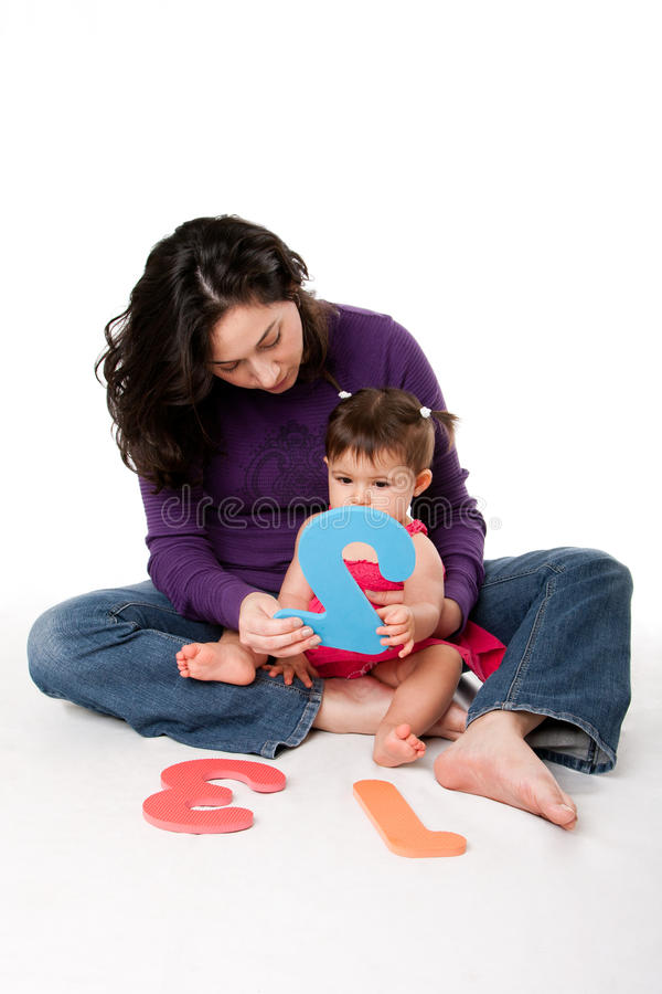 Baby learning to count stock image