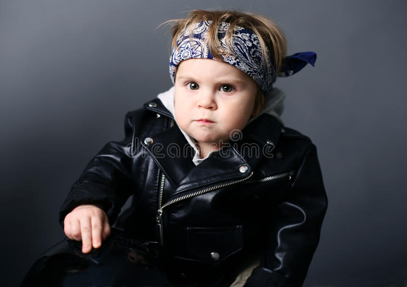 Baby in leather jacket stock image