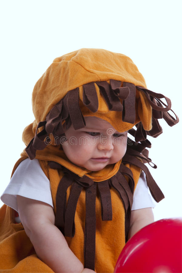 Baby with a lion mask stock image