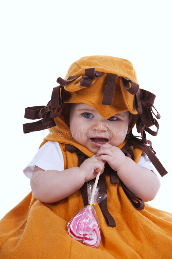 Baby With A Lion Mask Stock Photography