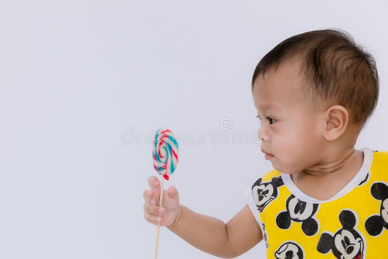 Baby with lollipop, happy birthday card . Fashion baby boy. Baby  with lollipop, happy birthday card .  Fashion baby boy. Trendy boy with lollipop. funny cute stock images