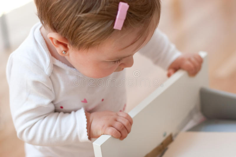 Baby looking inside a drawer royalty free stock images