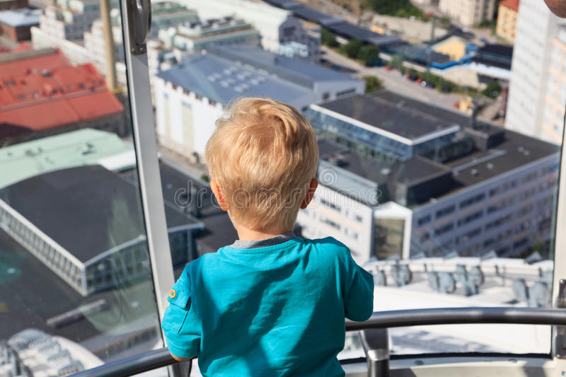 Baby looking at Stockholm royalty free stock image