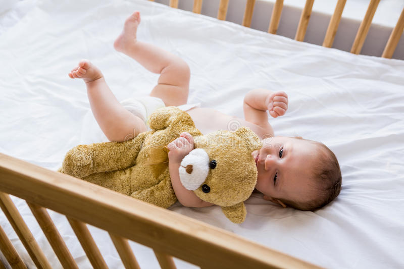 Baby lying on baby bed. At home royalty free stock photography