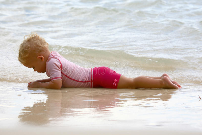 Download Baby lying on the beach stock photo. Image of smile, shallow - 12586620