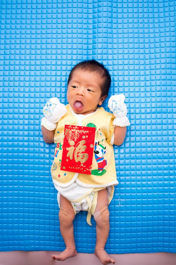 Baby Lying with Chinese Red Envelope stock photography