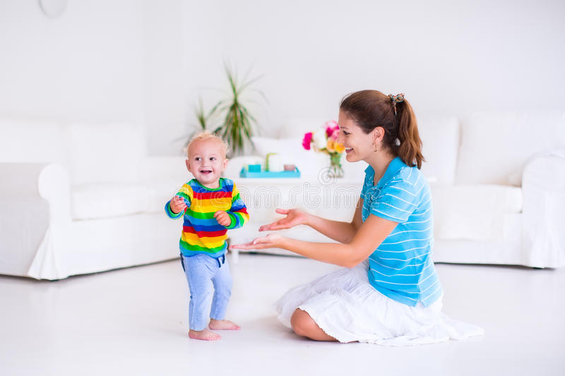 Baby making his first steps royalty free stock photo