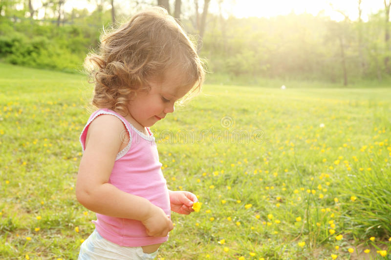 Download Baby in a Meadow stock image. Image of contemplation - 25085173
