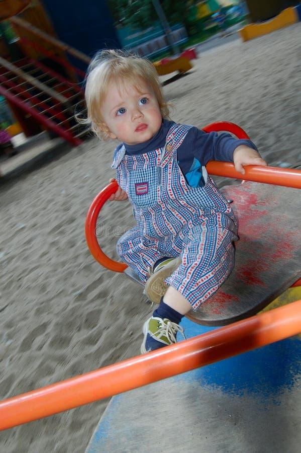 Baby on merry-go-round royalty free stock photos