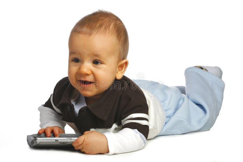 Baby met afstandsbediening royalty-vrije stock afbeeldingen