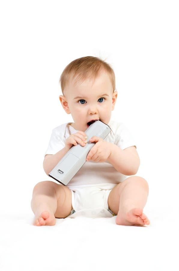 Baby met afstandsbediening royalty-vrije stock foto's