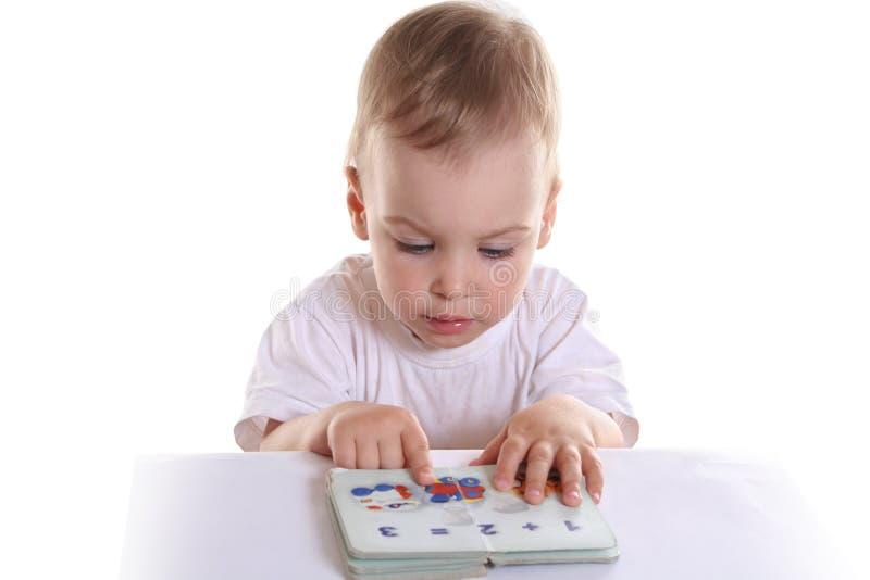 Baby met boek 2 royalty-vrije stock afbeeldingen