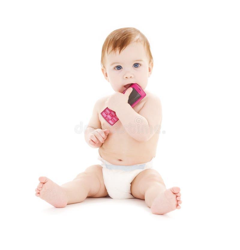 Baby met celtelefoon royalty-vrije stock afbeeldingen