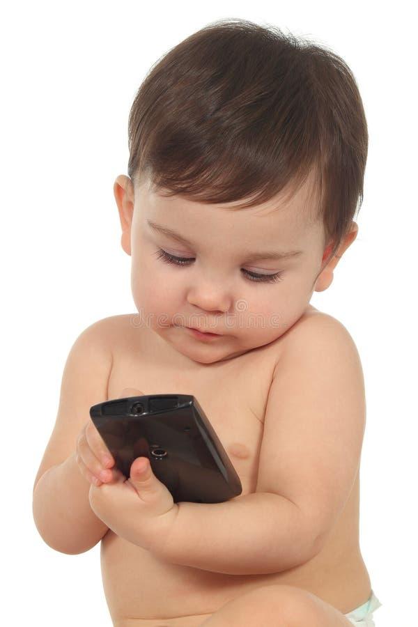 Baby met een mobiele telefoon stock fotografie