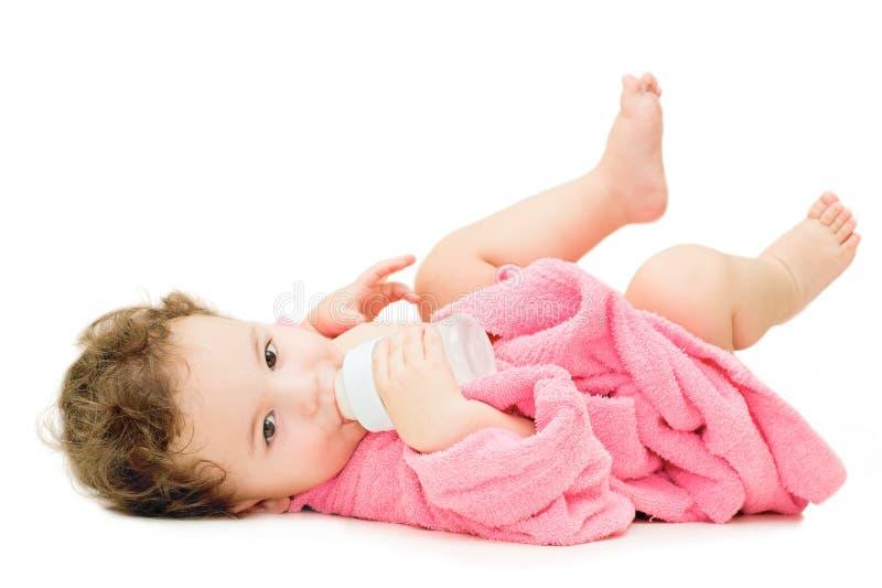 Baby met fles stock foto