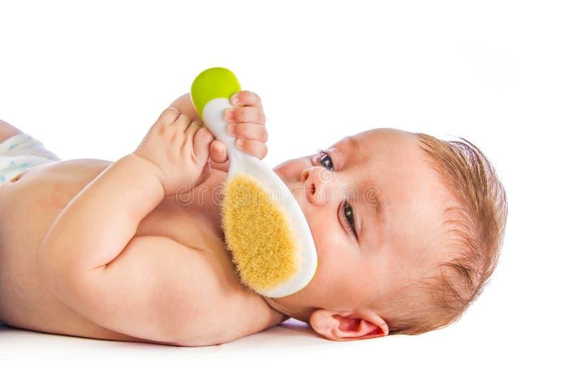 Baby met haarborstel royalty-vrije stock foto