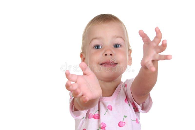 Baby met handen aan u stock fotografie