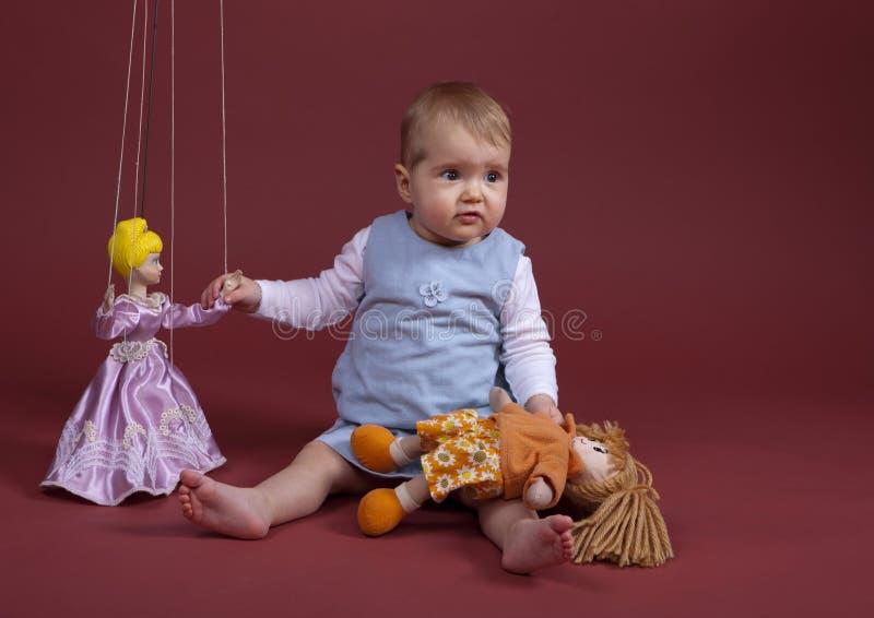 Baby met marionet stock afbeelding