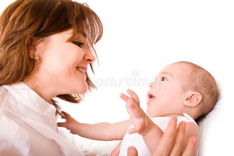 Baby met moeder stock foto