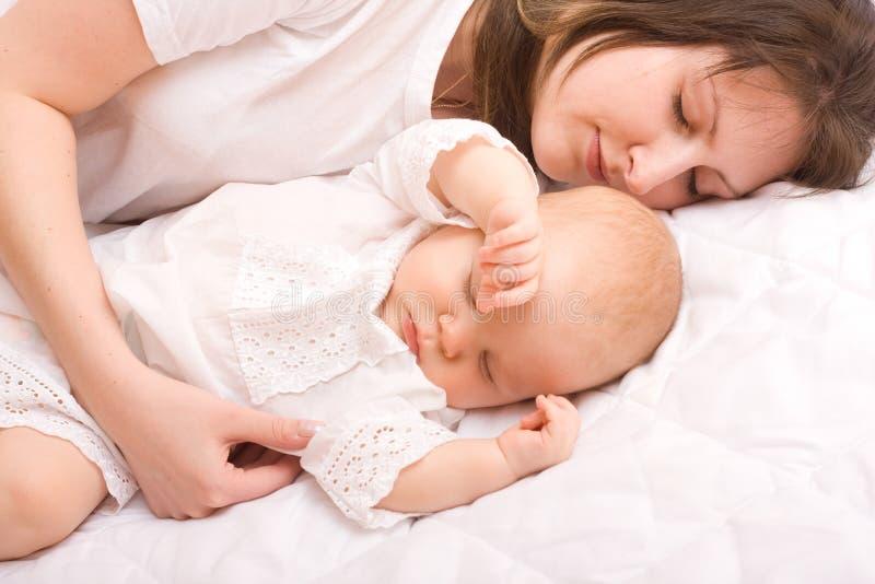 Baby met moeder stock fotografie