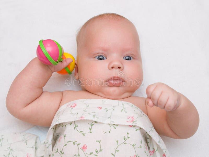 Baby met rammelaar royalty-vrije stock foto's