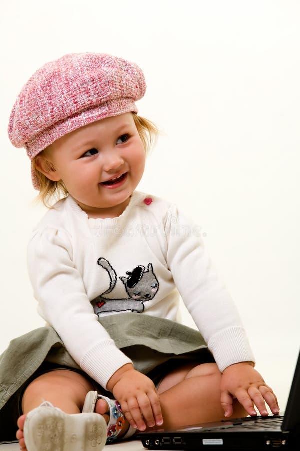 Baby met roze hoed royalty-vrije stock fotografie