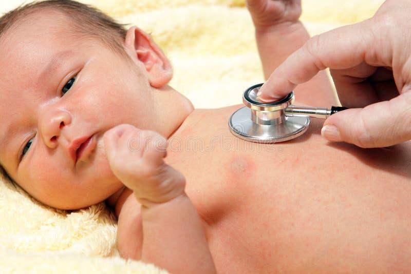 Baby met stethoscoop royalty-vrije stock foto's