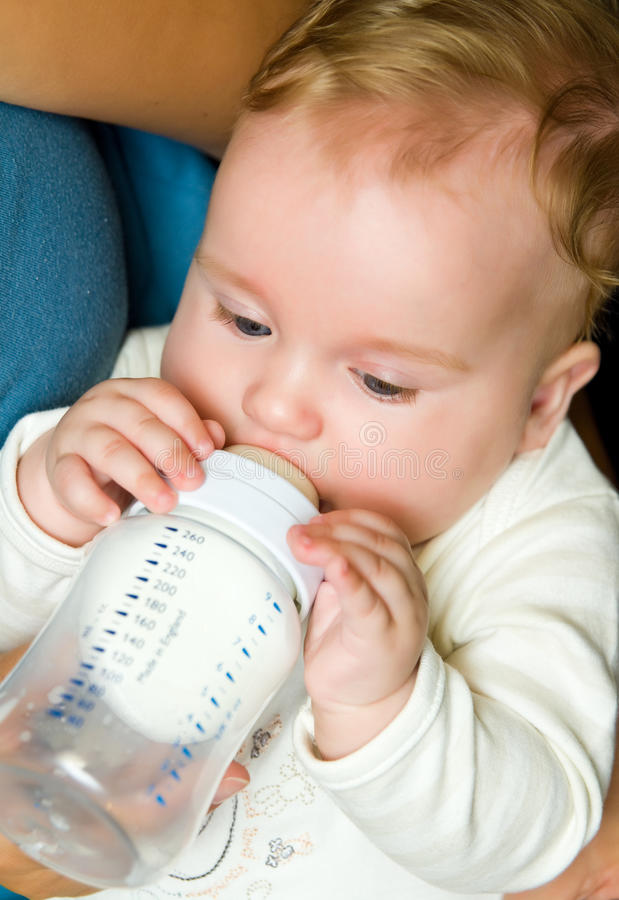 Baby with milk bottle royalty free stock photography