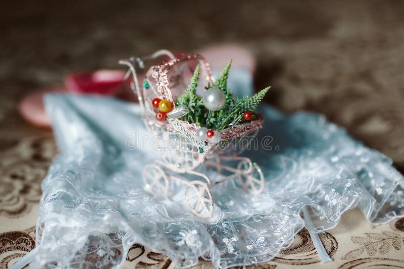 Baby miniature old fashioned baby buggy carriage, toys, decorations for photo shoot stock photos