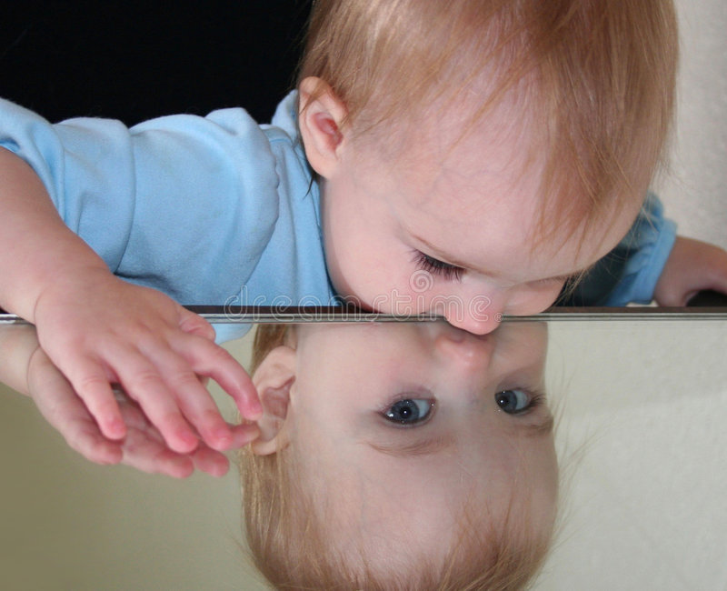 Baby in Mirror II stock image