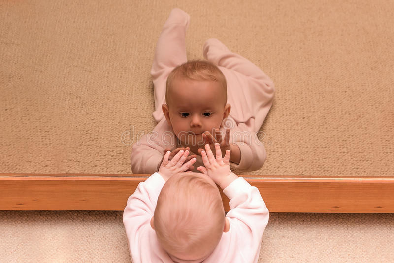 Baby in a mirror royalty free stock photo