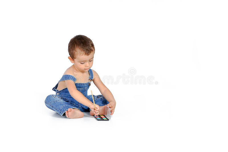 Baby mit einem Aquarell stockfoto