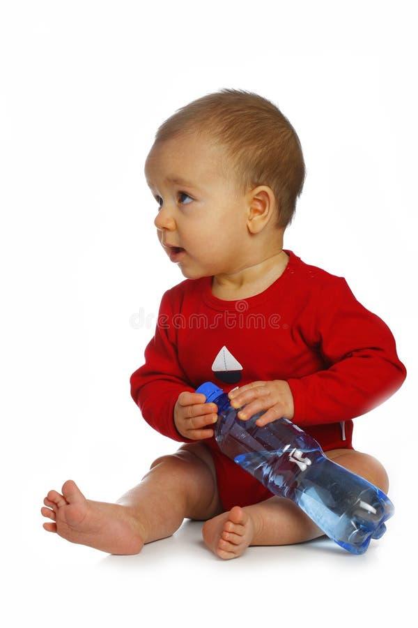 Baby mit Flasche lizenzfreies stockbild