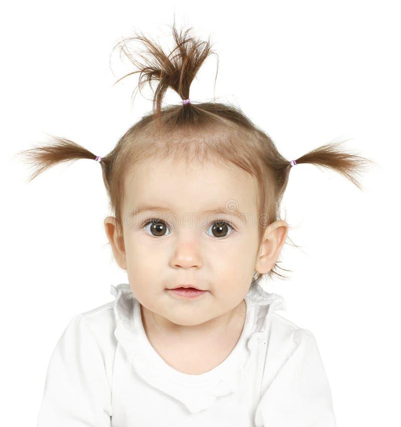 Baby mit lustigem Pferdeschwanz stockbild
