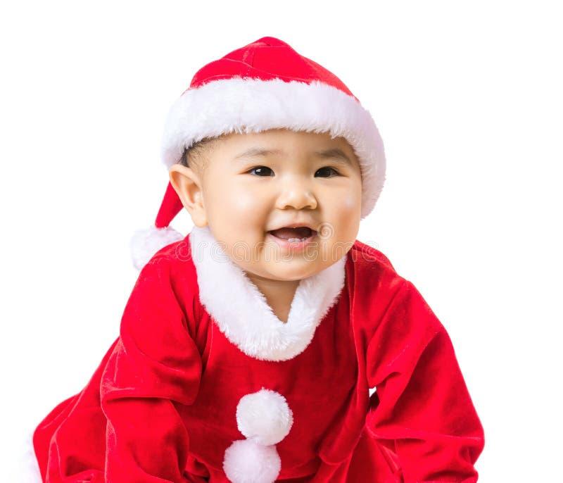 Baby mit Weihnachtsbehandlung stockbilder