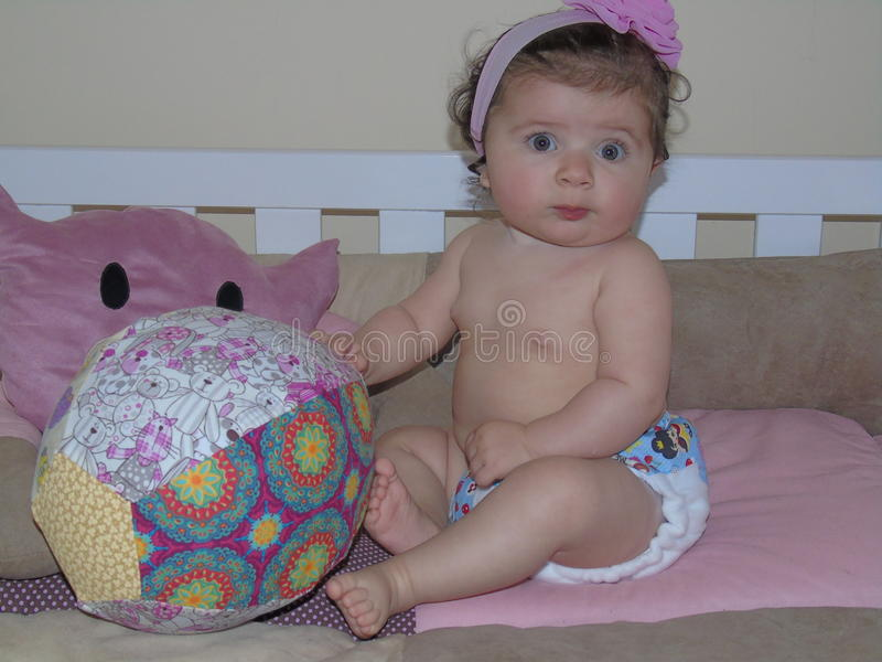 Baby in modern eco stacks of cloth diapers stock images