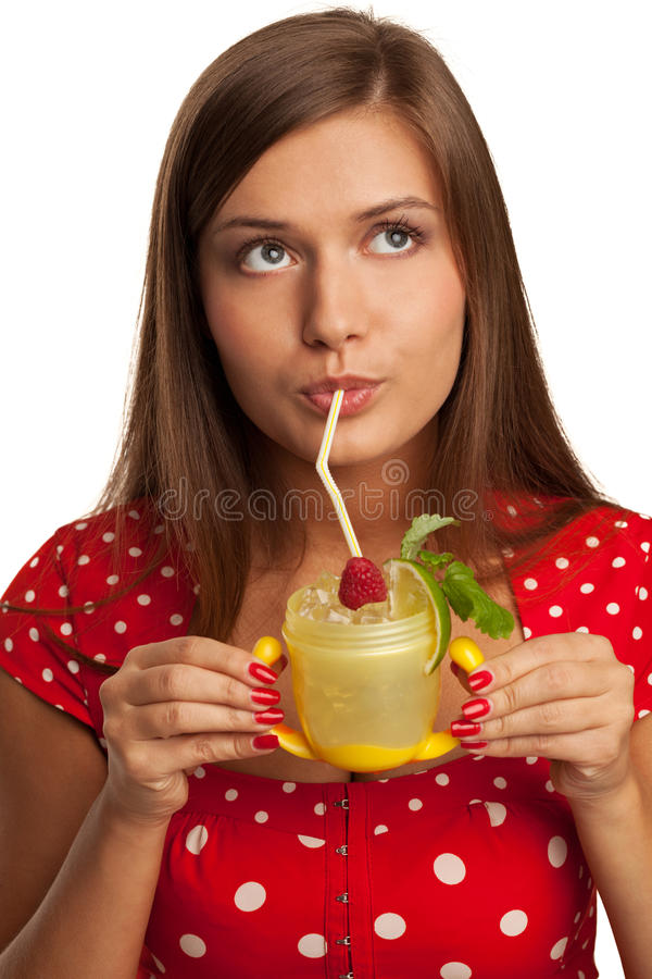 Baby mojito. Seductive girl with mojito in feeding cup royalty free stock photography