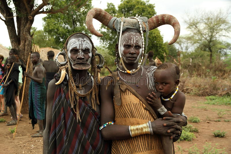 Baby, mom and grandmother of mursi ethnicity. The Mursi ethnic group lives in small villages in the valley of the OMO river in southwestern Ethiopia, very close royalty free stock photography