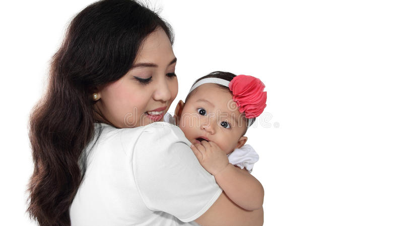 Baby on mom's shoulder stock photography