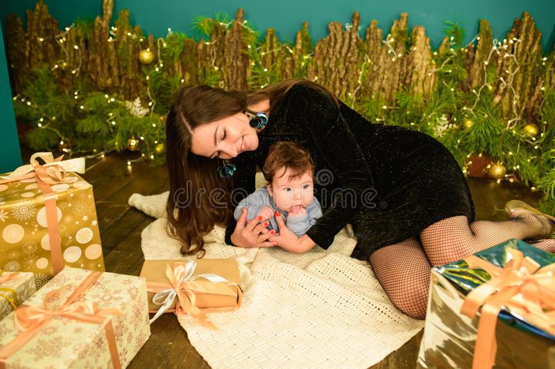 Baby with mother at Christmas. happy family mother and baby little son playing home on Christmas holidays. New Year`s holidays. stock photography