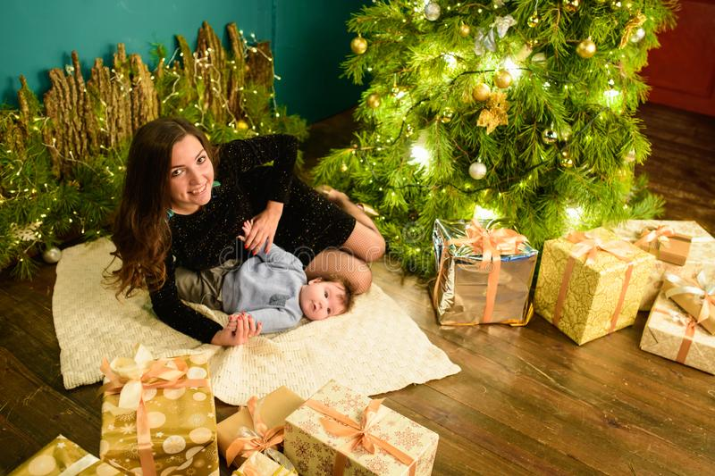 Baby with mother at Christmas. happy family mother and baby little son playing home on Christmas holidays. New Year`s holidays. stock images