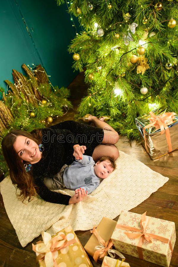 Baby with mother at Christmas. happy family mother and baby little son playing home on Christmas holidays. New Year`s holidays. stock photo