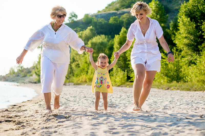 Baby, mother and grandmother together stock image